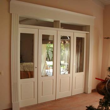 Fabrica de puertas plegadizas y rebatibles en madera y for Fabrica de aberturas de madera