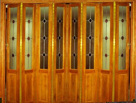 Fabrica de puertas plegadizas y rebatibles en madera y for Fabrica de puertas